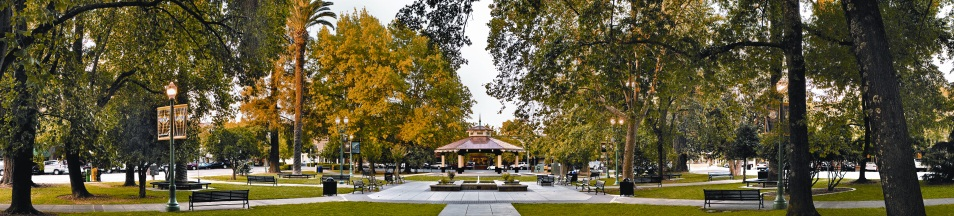A gazebo in the middle of a wooded city park